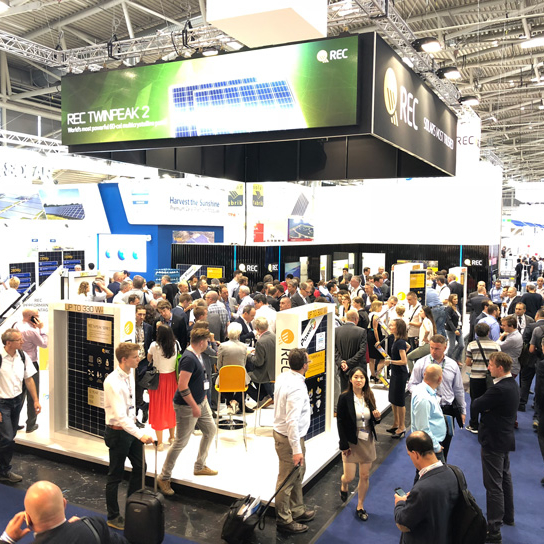 REC's popular exhibition stand at Intersolar Europe in Munich, filled with visitors interested in REC's premium solar panels