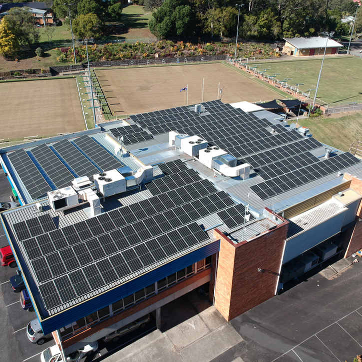 REC solar panels installed on commercial rooftop in Australia helps business reduce energy bills and make a positive impact on climate change
