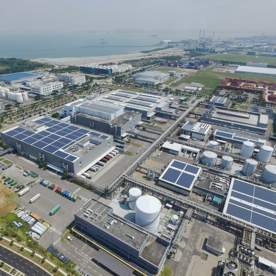 Aerial photo of REC's state-of-the-art solar manufacturing facility in Singapore, which has a 2.4-MW rooftop installation system directly contributing to the factory's energy needs