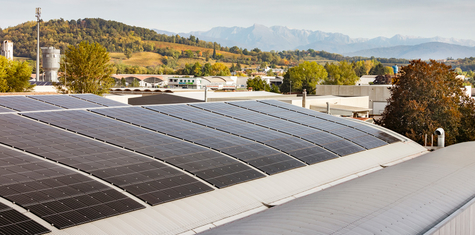 REC solar panels installed on commercial rooftop in Italy helps business reduce energy bills and make a positive impact on climate change