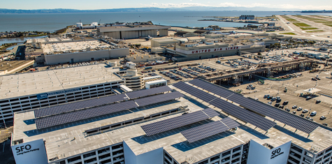 REC solar panels installed on commercial rooftop at SFO airport helps business reduce energy bills and make a positive impact on climate change
